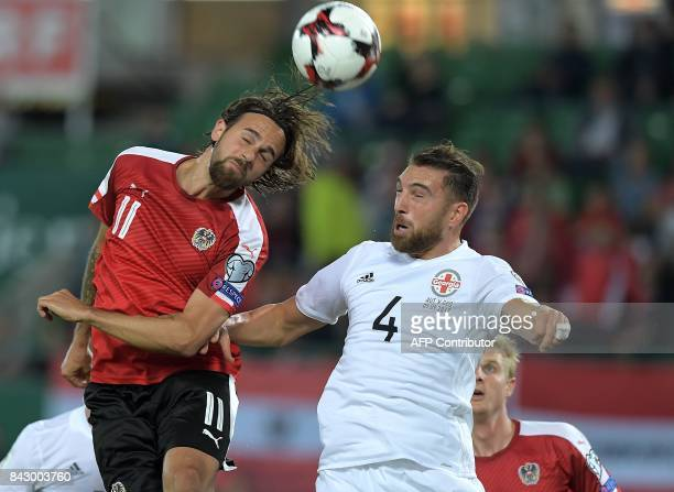 Austria's striker Martin Harnik and Georgia's defender Guram Kashia vie for the ball during the Group D FIFA World Cup 2018 qualification match...