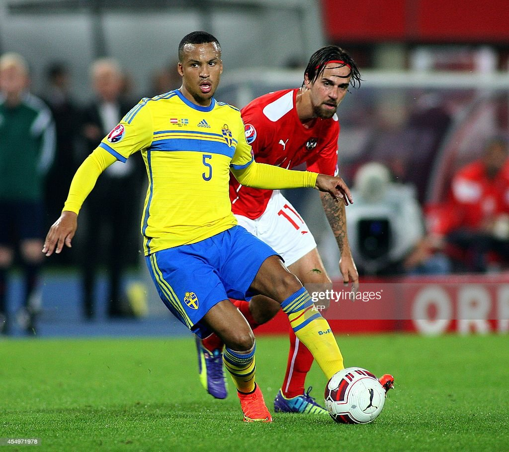Austria's striker Martin Harnik and Sweden's defender Martin Olsson vie for the ball during the UEFA Euro 2016 Group G qualifying football match...