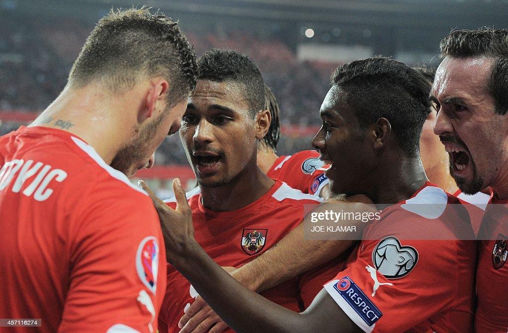 Austria's striker Rubin Okotie celebrate scoring the 10 goal with his teammates striker Marko Arnautovic and midfielder David Alaba during the Euro...