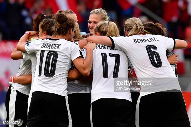 Austria's team players celebrate after scoring a goal during the UEFA Women's Euro 2017 football tournament between France and Austria at the...