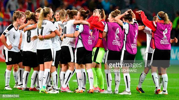 Austria's team players celebrate at the end of the UEFA Women's Euro 2017 football tournament between France and Austria at the Galgenwaard Stadium...