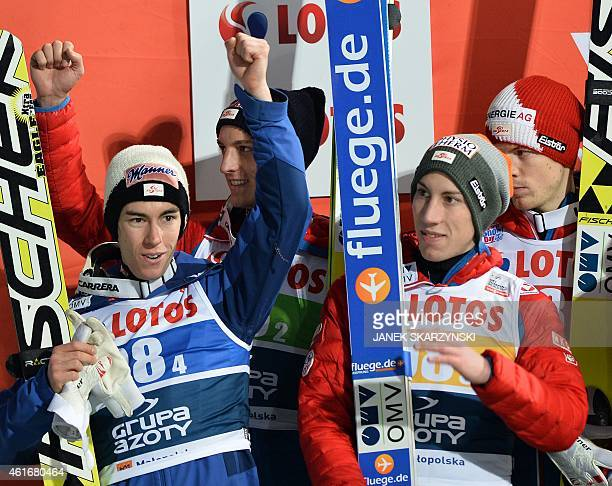 Austria's team Stefan Kraft Gregor Schlierenzauer Thomas Diethart and Michael Hayboeck celebrate on the podium of the team competition of the FIS Ski...