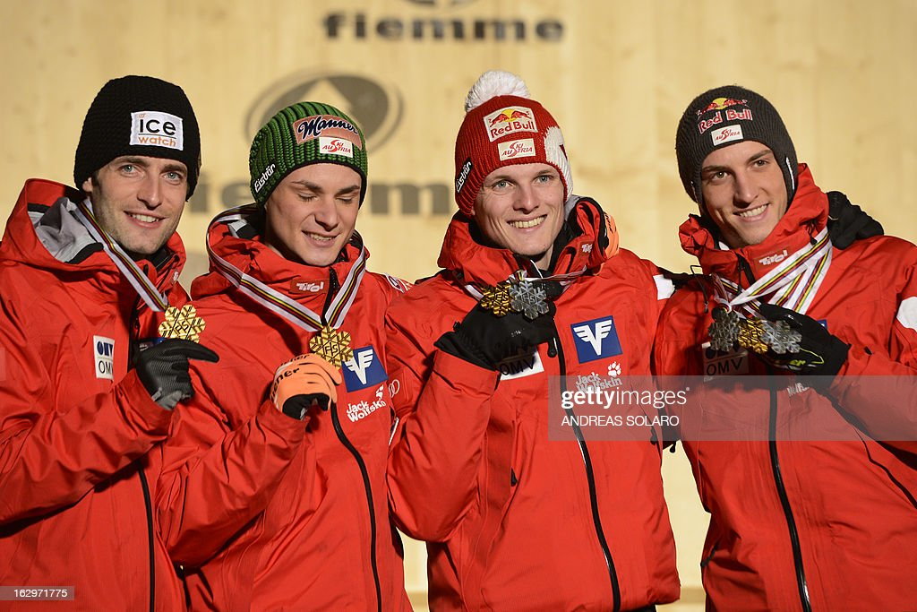 Austria's team (From L) Wolfgang Loitzl, Manuel Fettner, Thomas Morgenstern and Gregor Schlierenzauerpose pose on the podium with their gold medals at the medals ceremony of the Men's Ski Jumping Large Hill Team event of the FIS Nordic World Ski Championships at Cavalese, northern Italy on March 2, 2013.