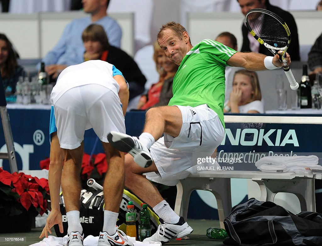 Austria's Thomas Muster jokes with Slovak Dominik Hrbaty during a charity exhibition match on November 22, 2010 in Bratislava.