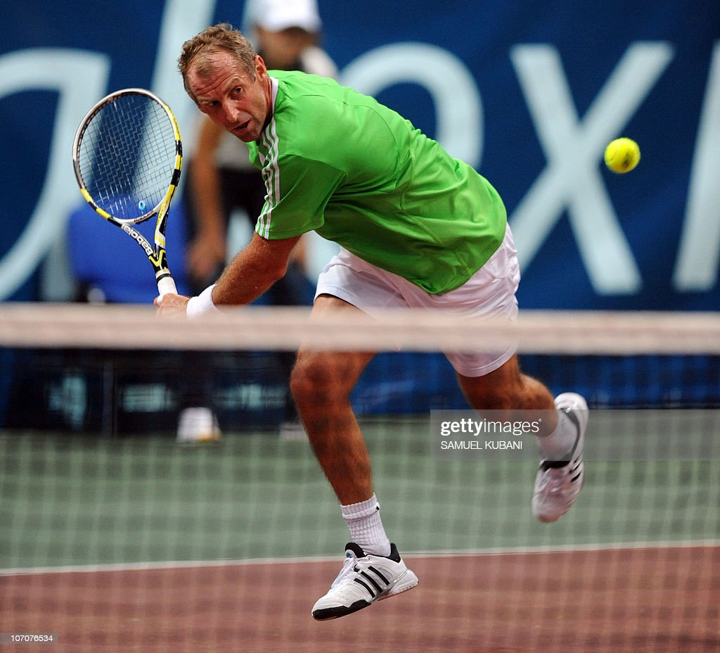Austria's Thomas Muster returns the ball to Slovak Dominik Hrbaty during a charity exhibition match on November 22, 2010 in Bratislava.