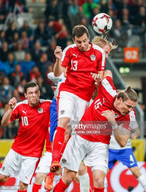 Austria's Zlatko Junuzovic Markus Suttner Finalsnd's Paulus Arajuuri and Austria's Sebastian Proedl vie for the ball during the friendly football...
