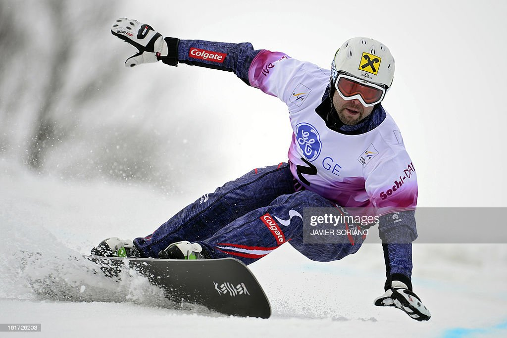 Austria'sAndreas Prommegger competes to win in a Snowboard Men Parallel Giant Slalom final race during the Snowboarding and Free Style World Cup Test Event at the Snowboard and Free Style Centre in Rosa Khutor near the Russian Black Sea resort of Sochi on February 14, 2013. AustrianAndreas Prommegger won the race ahead of Austrian Ingemar Walder and Slovenian Rok Flander.