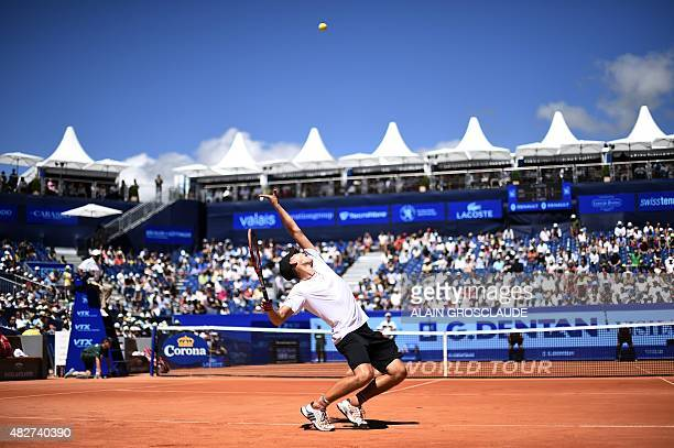 Austria'sDominic Thiem serves against Belgium's David Goffin during their final match at the ATP Swiss Open tennis tournament in Gstaad on August 2...