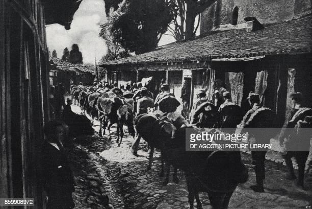 AustroHungarian supply column crossing the main street of Berat Albania World War I from l'Illustrazione Italiana Year XLV No 29 July 21 1918