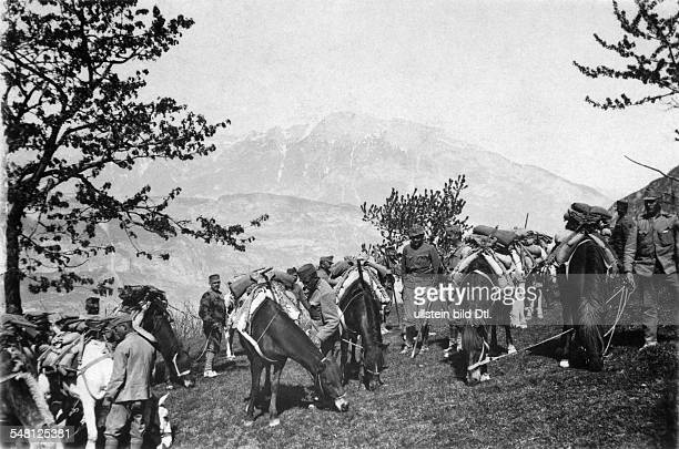 AustroHungarian troops with packhorses are having a rest above the Isonzo river in the Julian Alps Summer 1916