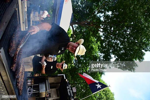 Authentic bbq chefs work smokey grill The annual Madison Square BBQ festival brought smoked specialists from all over the New York area to Midtown to...
