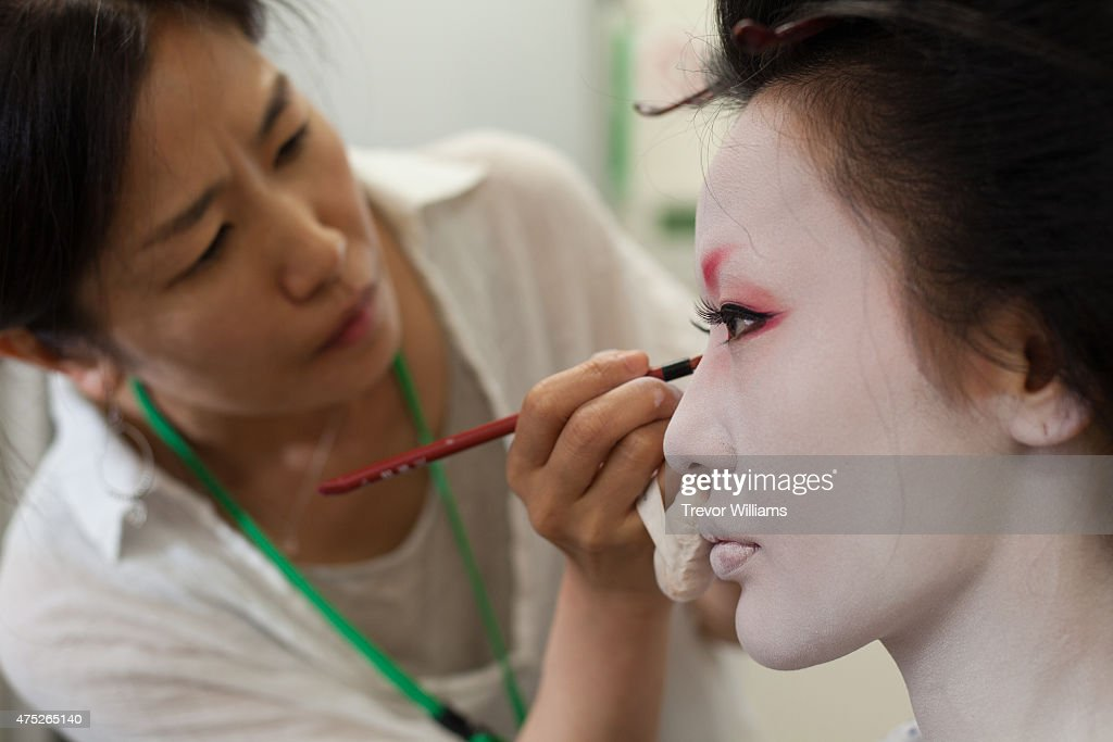 Authentic Edo era make up is applied during the Uzumasa Edosakaba, an event recreating an edo-period bar at the Toei Kyoto Studio Park on May 30, 2015 in Kyoto, Japan. The Toei Kyoto Studio Park, a studio park built next to a working film set, turned itself into a big edo-period bar where people can drink and enjoy edo period culture including Japanese cuisine and samurai sword fighting.