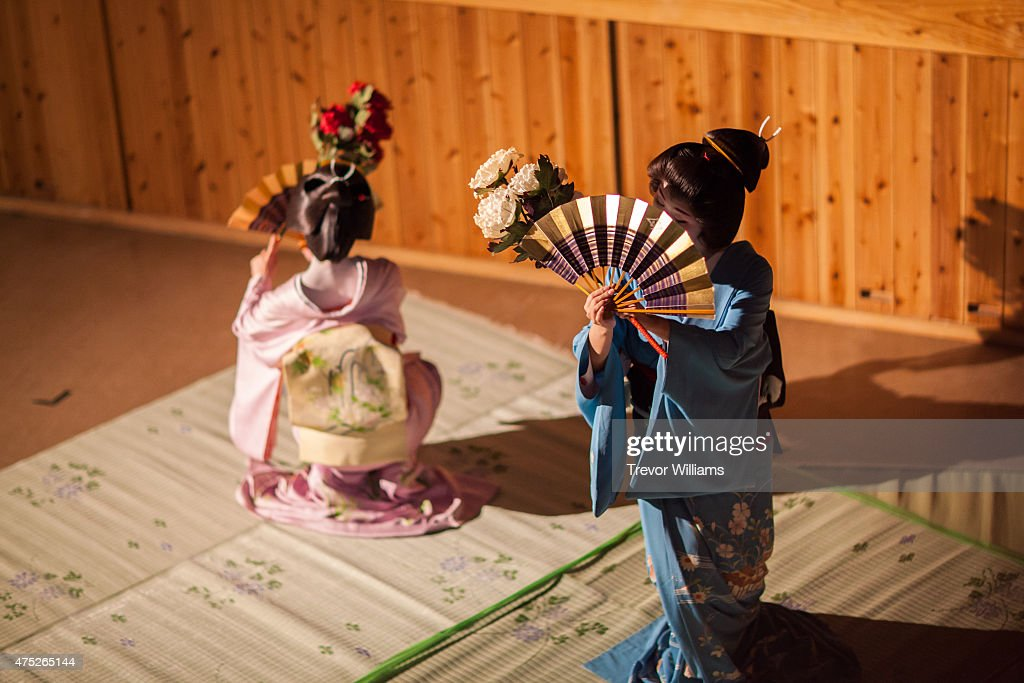 Authentic geisha perform during the Uzumasa Edosakaba, an event recreating an edo-period bar at the Toei Kyoto Studio Park on May 30, 2015 in Kyoto, Japan. The Toei Kyoto Studio Park, a studio park built next to a working film set, turned itself into a big edo-period bar where people can drink and enjoy edo period culture including Japanese cuisine and samurai sword fighting.