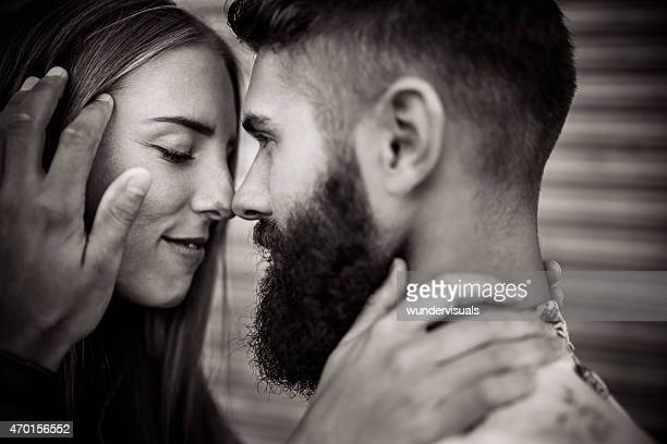 Authentic hipster guy looking lovingly at his girlfriend
