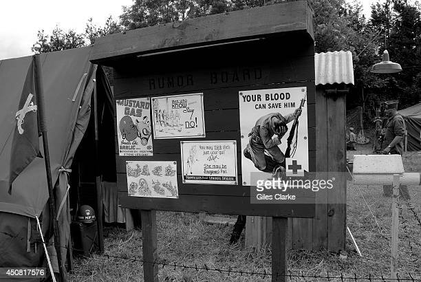 Authentic World War 2 propaganda and rumor board hang at a recreated encampment Camp Arizona June 3 2014 in Normandy France The 70th anniversary of...