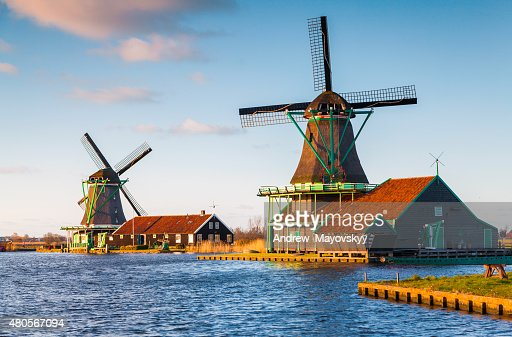 Authentic Zaandam mills on the water channel in Zaanstad village : Stock Photo