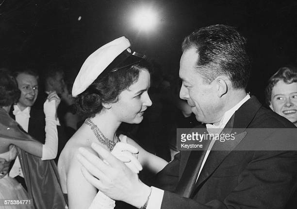 Author Albert Camus dancing with actress Torun Moberg after being awarded the Nobel Prize for Literature at Concert Hall in Stockholm December 10th...
