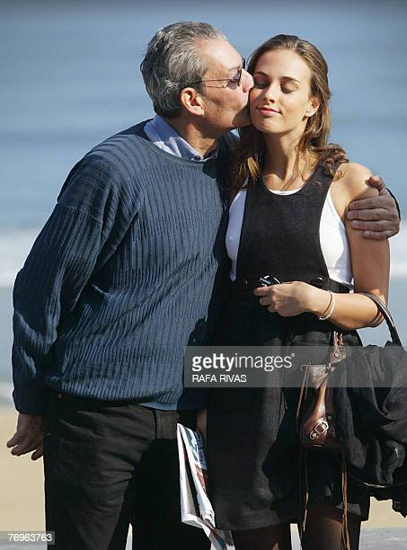 US author and film director Paul Auster kisses his daughter Sophie as they pose for photographers after the screening of their film 'The Inner Life...
