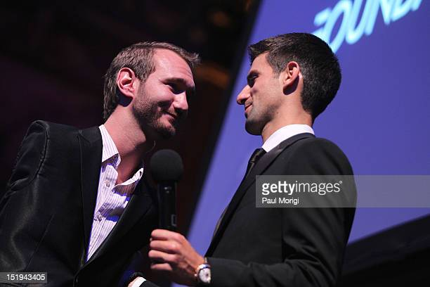 Author and inspirational speaker Nick Vujicic and tennis player Novak Djokovic founder and honorary chair speak on stage during The Novak Djokovic...