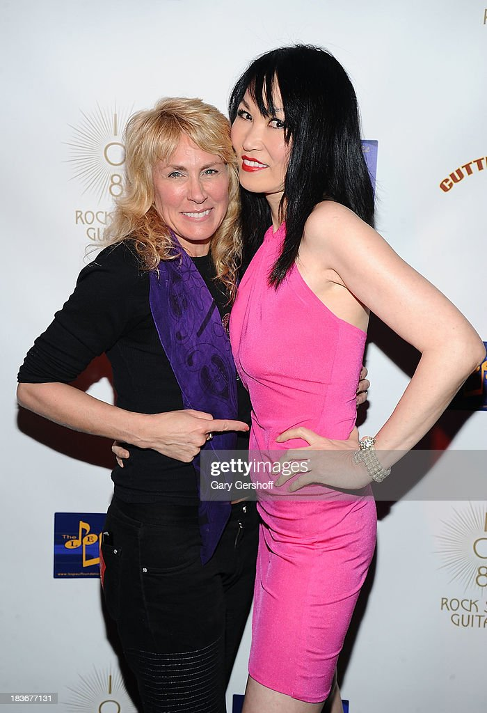 Author and photographer Lisa Johnson (L) and Joanna Ha attend the book launch and performance for '108 Rock Star Guitars' benefitting The Les Paul Foundation at The Cutting Room on October 8, 2013 in New York City.