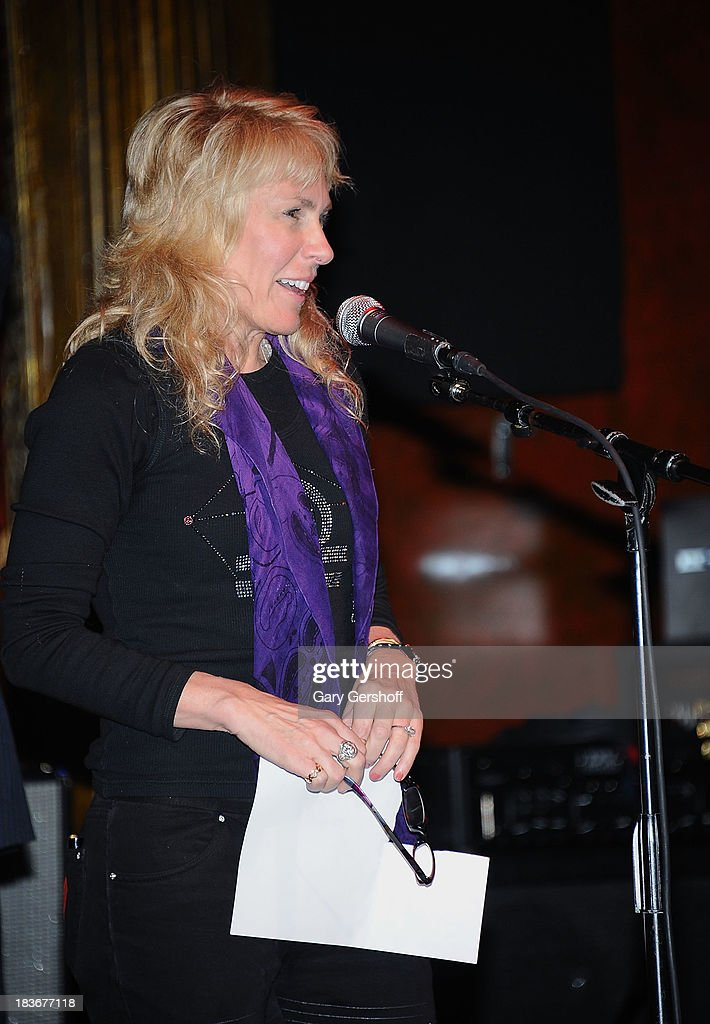 Author and photographer Lisa Johnson speaks on stage for the book launch of '108 Rock Star Guitars' benefitting The Les Paul Foundation at The Cutting Room on October 8, 2013 in New York City.