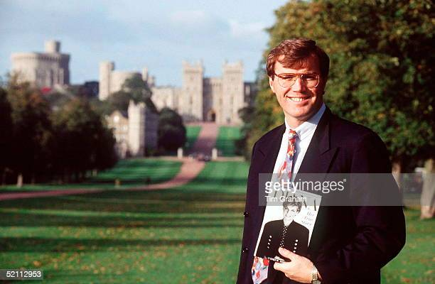 Author Andrew Morton In Front Of Windsor Castle Holding A Copy Of His Book On Diana