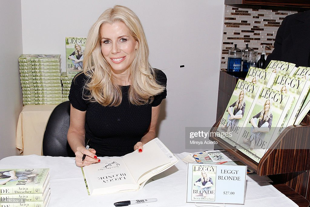 Author Aviva Drescher signs books at the 'Leggy Blonde' Book Event at Angelo David Salon on March 12, 2014 in New York City.