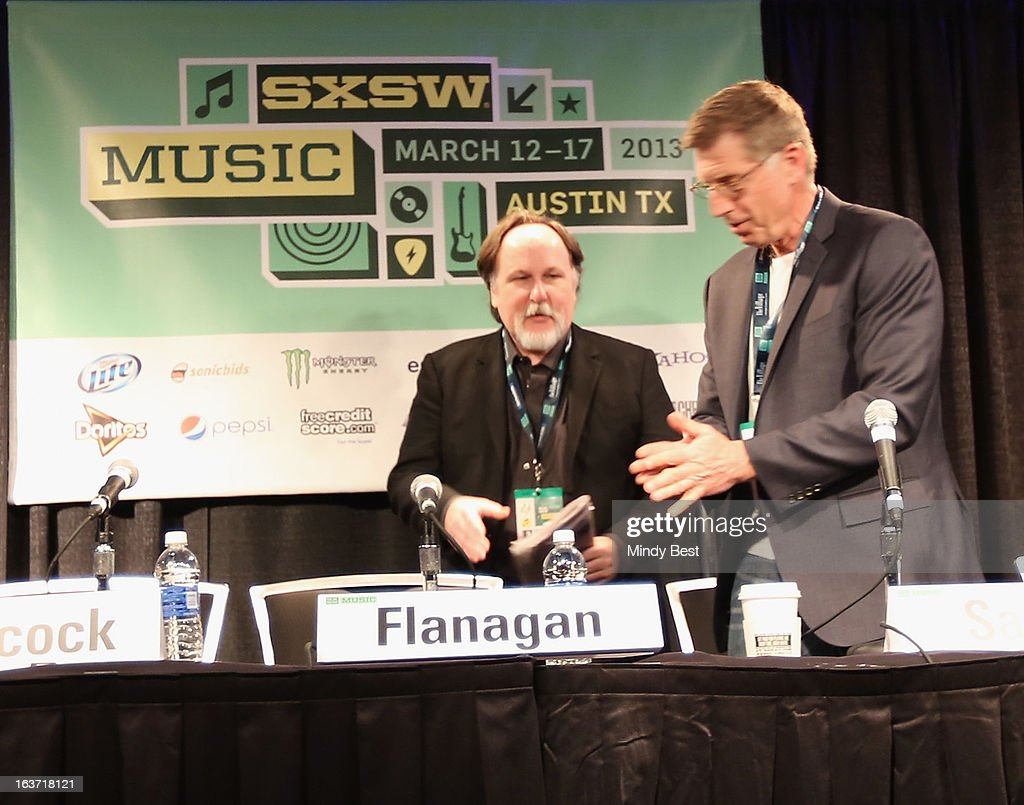 Author Bill Flanagan and Director of The Grammy Museum Bob Santelli speak onstage at 50 Years of the Beatles during the 2013 SXSW Music, Film + Interactive Festival at Austin Convention Center on March 14, 2013 in Austin, Texas.
