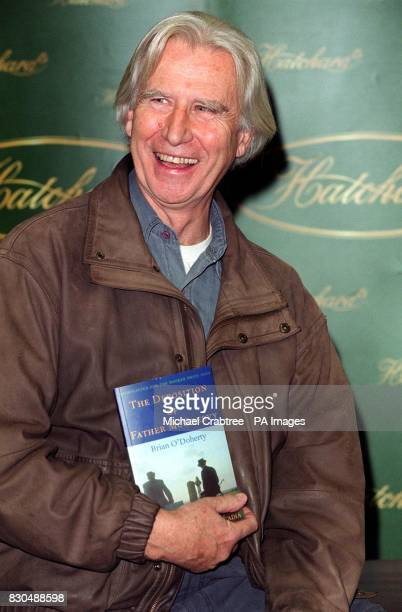 Author Brian O'Doherty with his book The Deposition of Father McGreevyat Hatchards bookshop in Piccadilly central London The title is one of six...