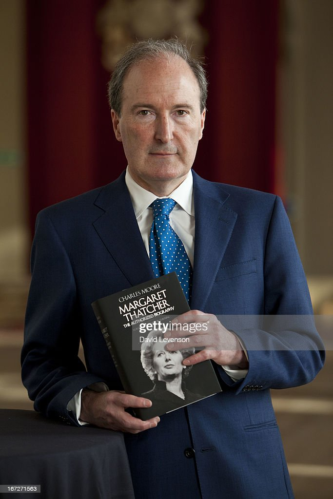 Author Charles Moore holds a copy of his book, at the launch of 'Margaret Thatcher - The Authorised Biography, Volume One: Not for Turning' by Charles Moore at Banqueting House on April 23, 2013 in London, England.