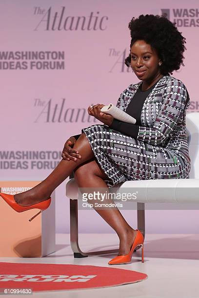 Author Chimamanda Ngozi Adichie reads from one of her novels during the Washington Ideas Forum at the Harman Center for the Arts September 28 2016 in...