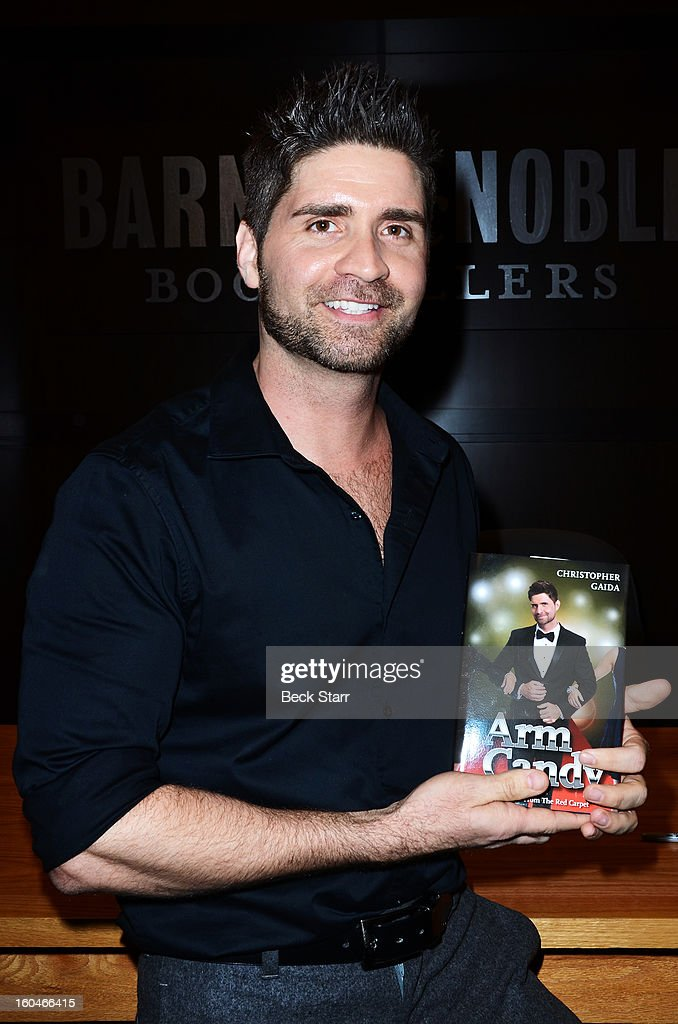 Author Chris Gaida signs copies of his new book 'Arm Candy: A Celebrity Escort's Tales From The Red Carpet' at Barnes & Noble bookstore at The Grove on January 31, 2013 in Los Angeles, California.