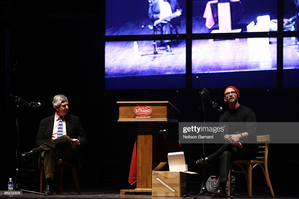 Author Chuck Palahniuk (R) speaks to the audience during a reading hosted by Strand Bookstore at Webster Hall May 6, 2009 in New York City.