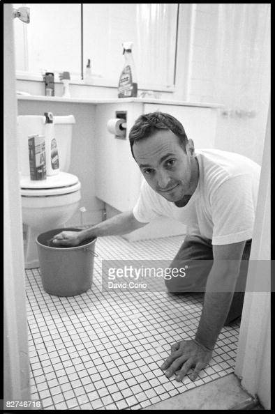 Author David Sedaris cleans his apartment at Astor Place on June 28 1993 in New York City New York