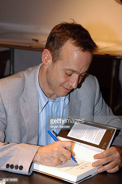 Author David Sedaris signs a book for a fan at the Symphony Space with David Sedaris presents selected shorts June 2 2004 in New York City