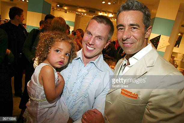 Author David Strah holds his twoyearold daughter Summer as his partner Barry Miguel stands nearby as they attend a party celebrating Father's Day as...