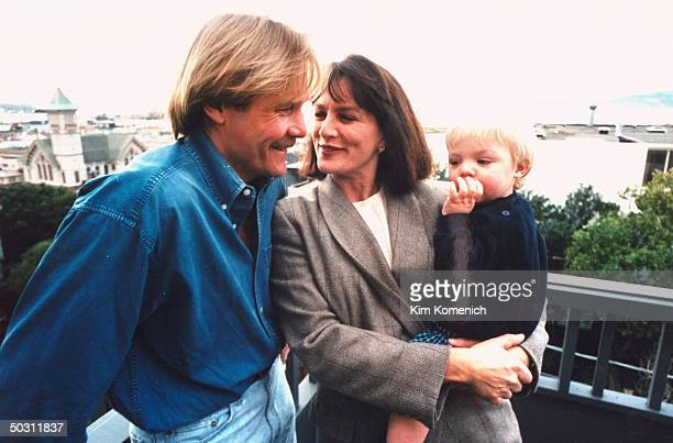 Author Dr Nancy Snyderman TV producer husband Doug Meyers posing w son Charlie outside home
