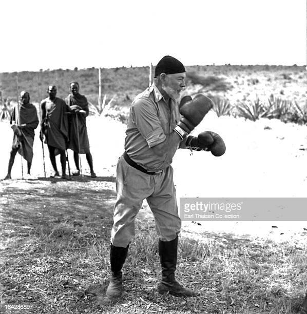 Author Ernest Hemingway keeps fit by boxing while on a big game hunt in September 1952 in Kenya
