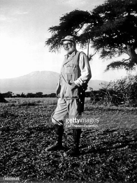 Author Ernest Hemingway poses for a portrait at Mount Kilimanjaro while on a big game hunt in September 1952 in Kenya