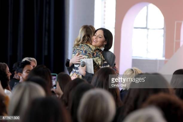 Author Gabby Bernstein and Girlboss Founder CEO Sophia Amoruso hug onstage at Girlboss Rally Hosted By Sophia Amoruso's Girlboss on November 11 2017...