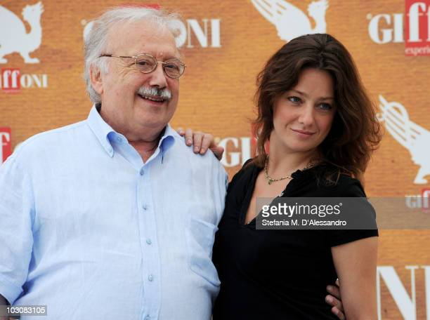 Author Gianni Mina and actress Giovanna Mezzogiorno attend a photocall during the Giffoni Experience on July 25 2010 in Giffoni Valle Piana Italy