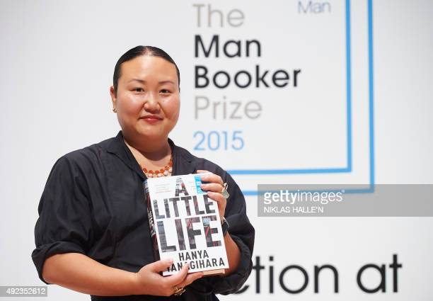 US author Hanya Yanagihara poses for a photograph at a photocall in London on October 12 ahead of tomorrow's announcement of the winner of the 2015...