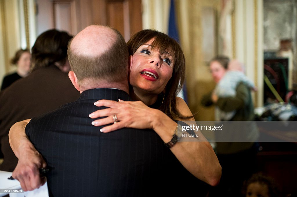 Author Heidi Murkoff hugs Sen. Chris Coons (D-DE) before the start of the Senate Democrats' news conference in the Capitol on Wednesday, May 25, 2016, to demand that the full Congress immediately pass emergency funding to combat the spread of the Zika virus in the United States.