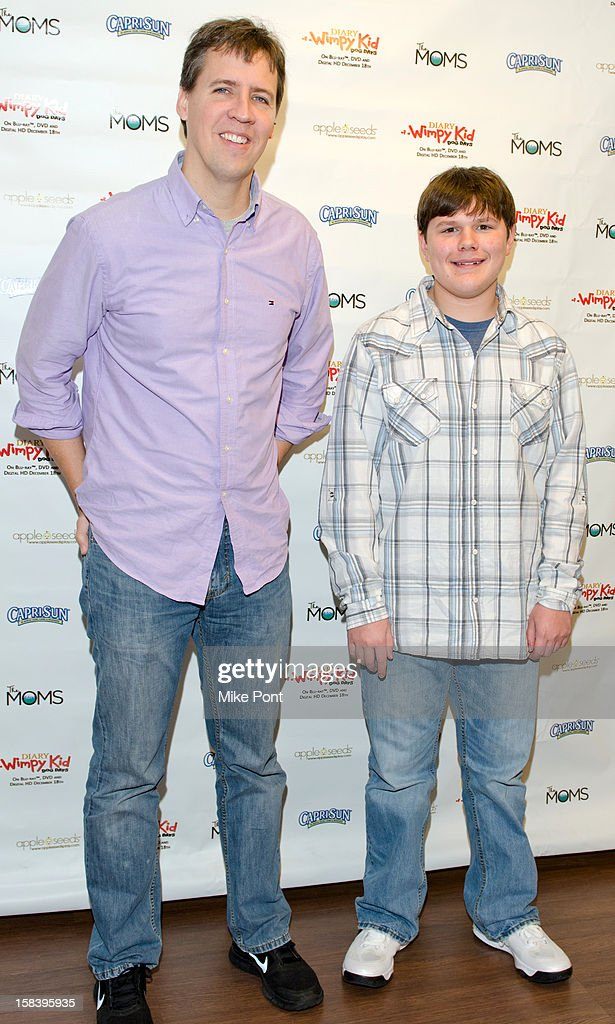 Author Jeff Kinney and Robert Capron attend 'Diary Of A Wimpy Kid: Dog Days' DVD Release Launch Event at apple seeds on December 15, 2012 in New York City.