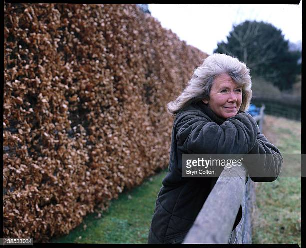 Author Jilly Cooper poses for a photograph leaning on a paddock fence at her home in Bisley UK on Friday February 4 2000 Cooper is the author of many...