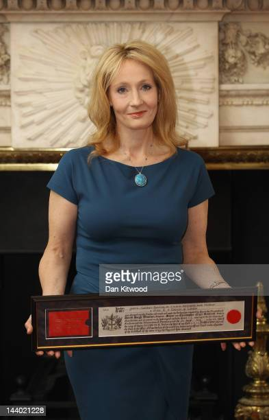 Author JK Rowling holds a certificate after being presented with the Freedom of the City of London at Mansion House on May 8 2012 in London England