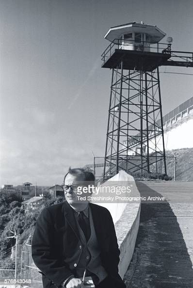 Author John Gregory Dunne stands near a gurad tower at Alcatraz Prison which was closed in 1963 and administered as part of the Golden Gate National...