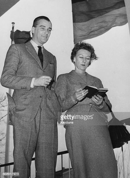 Author Jose Luis de Vilallonga and his wife Priscilla ScottEllis smoking cigarettes during a visit to Berlin February 20th 1959