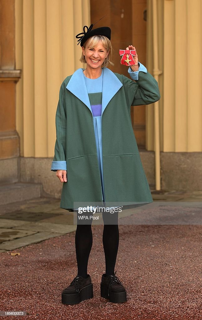 Author Kate Mosse poses with her medal after being made a Order of the British Empire (OBE) by the Prince of Wales during an Investiture ceremony on October 23, 2013 at Buckingham Palace, London, England.