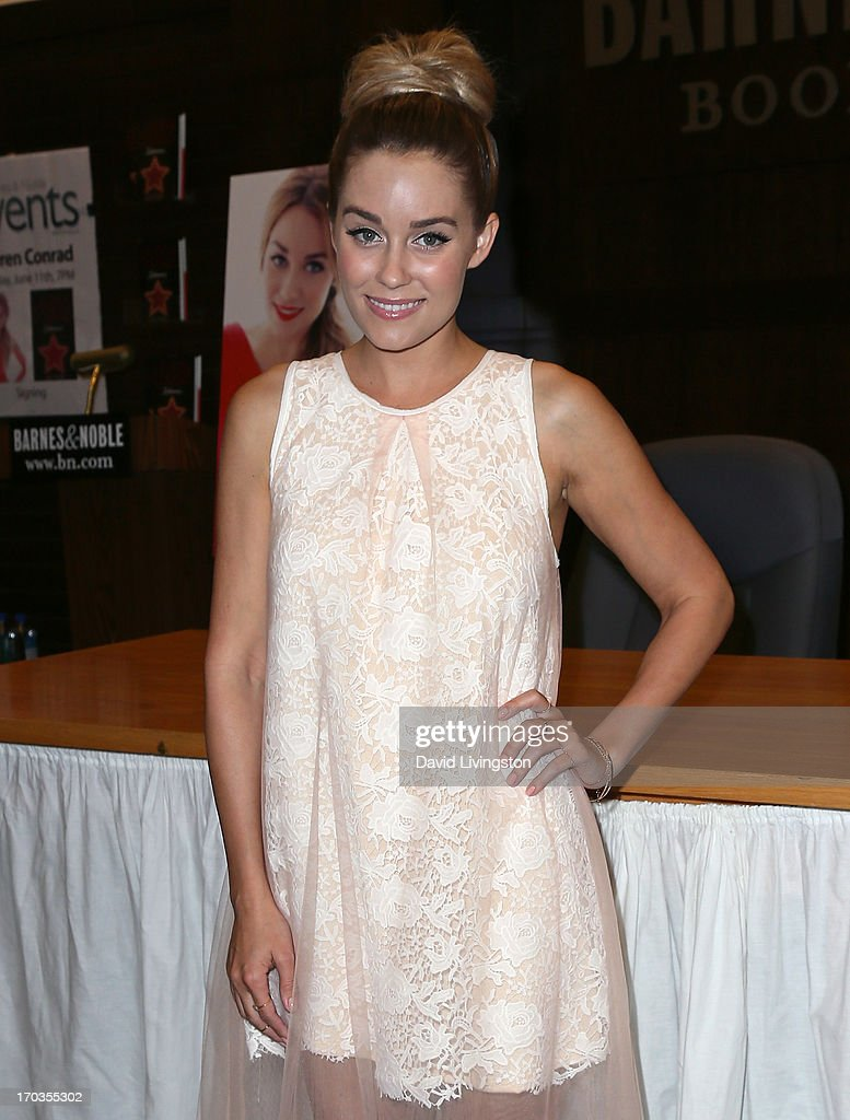 Author <a gi-track='captionPersonalityLinkClicked' href=/galleries/search?phrase=Lauren+Conrad&family=editorial&specificpeople=537620 ng-click='$event.stopPropagation()'>Lauren Conrad</a> attends a signing for her book 'Infamous' at Barnes & Noble bookstore at The Grove on June 11, 2013 in Los Angeles, California.